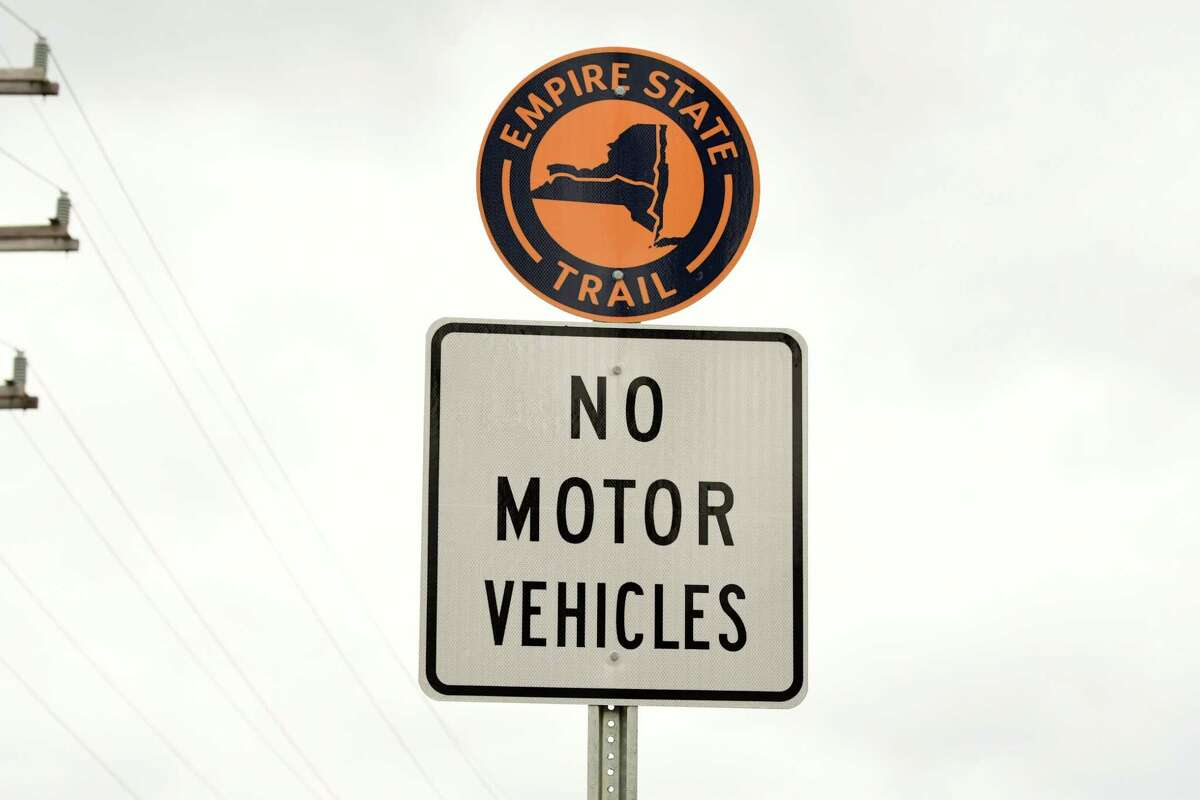 This sign with the symbol for the new Empire State Trail is ubiquitous along the 750-mile multi-use trail on Thursday, Dec. 31, 2020 in East Greenbush, N.Y. New York State Governor Andrew Cuomo announced that today the trail is officially completed. The trail runs from Manhattan north to the Canadian border in Rouses Point, near the northern tip of Lake Champlain, and also from Buffalo to Albany. (Lori Van Buren/Times Union)