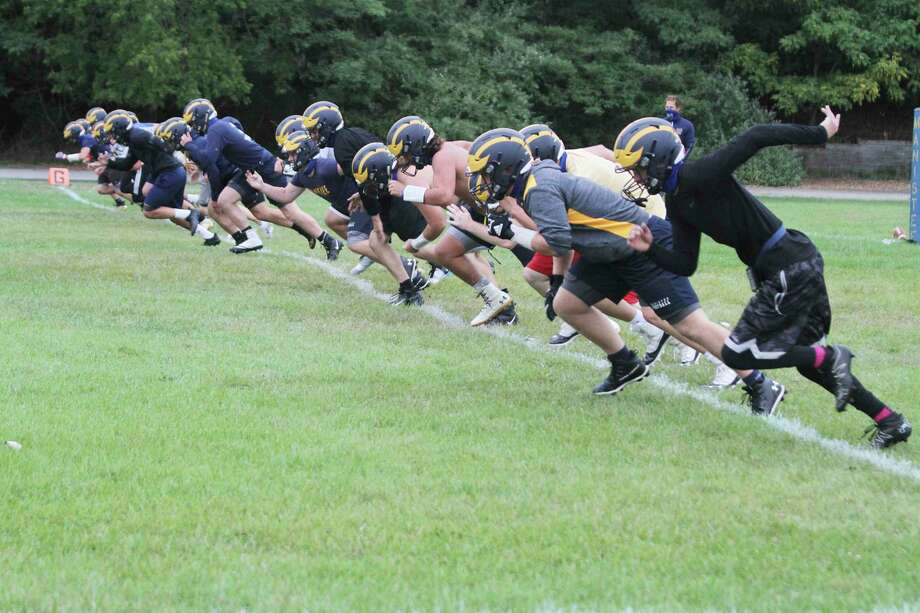 The Manistee football team runs drills on the first day of practice after the Michigan High School Athletic Association reinstated the sport for a fall season. (News Advocate file photo)