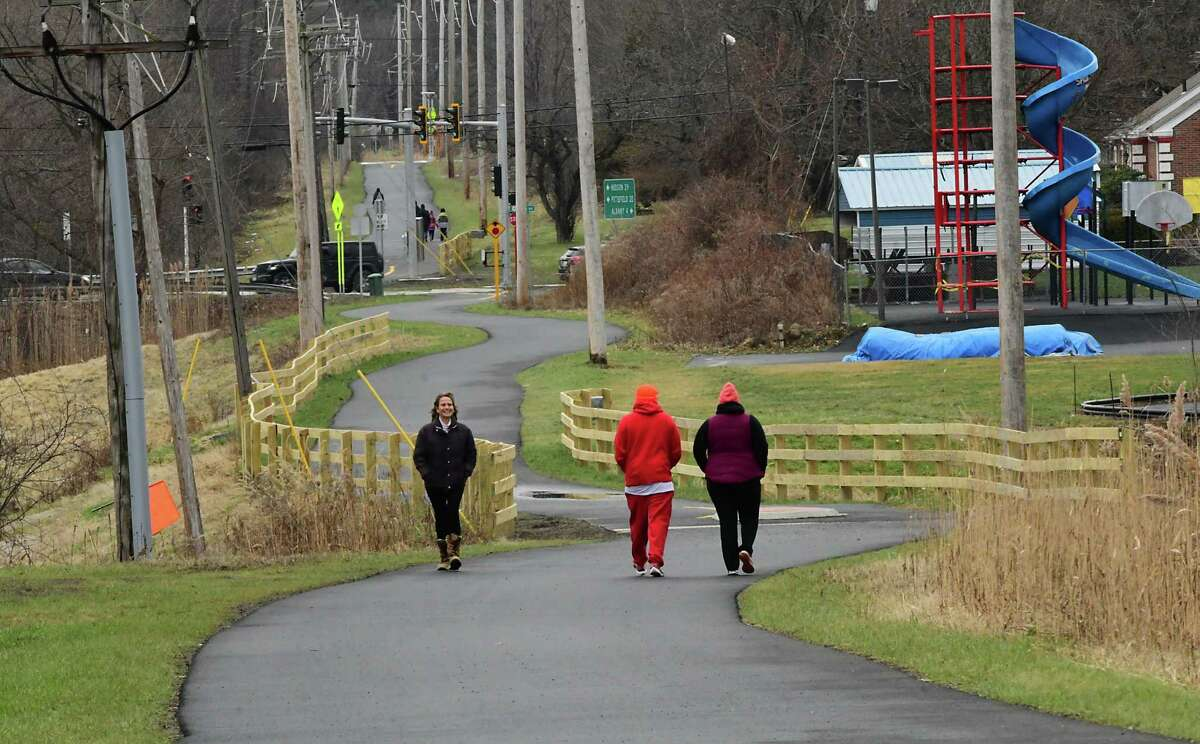 People are seen using the Empire State Trail on Thursday, Dec. 31, 2020 in East Greenbush, N.Y. New York State Governor Andrew Cuomo announced that today the trail is officially completed. The 750-mile multi-use trail runs from Manhattan north to the Canadian border in Rouses Point, near the northern tip of Lake Champlain, and also from Buffalo to Albany. (Lori Van Buren/Times Union)