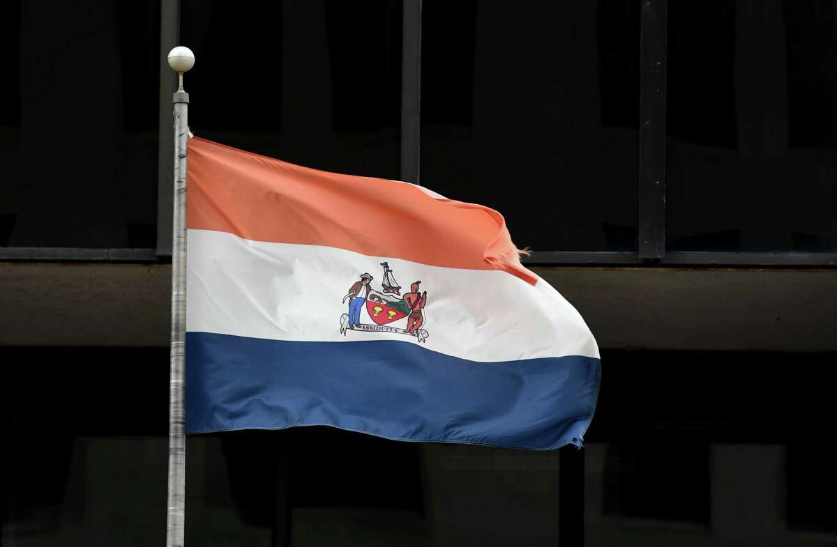 The City of Albany flag is flown outside One Commerce Plaza on Thursday, Dec. 31, 2020, on Washington Avenue in Albany, N.Y. A proposed city council resolution calls for a commission to look at overhauling the city?•s flag, saying the historic Dutch flag it is based upon was later co-opted by racist far-right political organizations. (Will Waldron/Times Union)