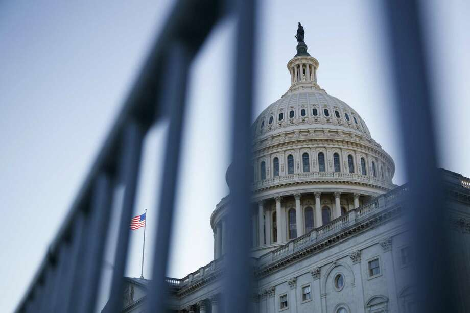 """President Donald Trump is """"trying to give Americans a $2,000 stimulus check per person instead of the crumbs the Democrat-controlled House doled out, which was a meager $600,"""" a reader says about the president's refusal to sign last week's COVID-19 relief bill. Photo: Ting Shen /Bloomberg / © 2020 Bloomberg Finance LP"""