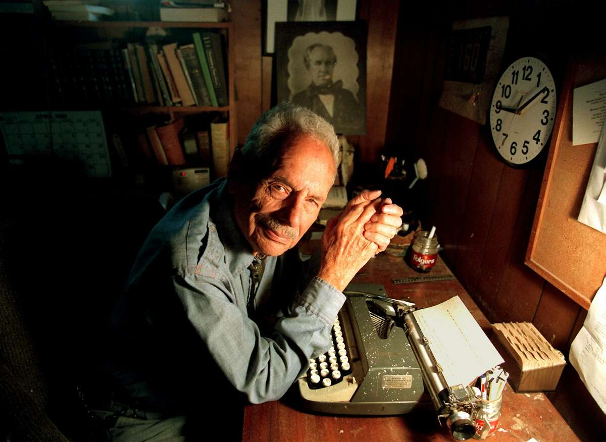 Maury Maverick sits with his typewriter, a photo of Sam Houston in the background, in 2003. The fearless civil rights advocate, legislator, columnist and patriot would have turned 100 today.