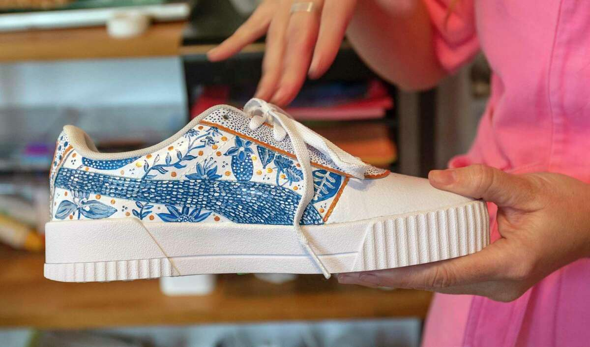 """When Daniela Oliver de Portillo hand-painted a pair of canvas shoes Daniela for herself, they were so popular she quickly received """"commissions"""" for more than a dozen from family and friends."""