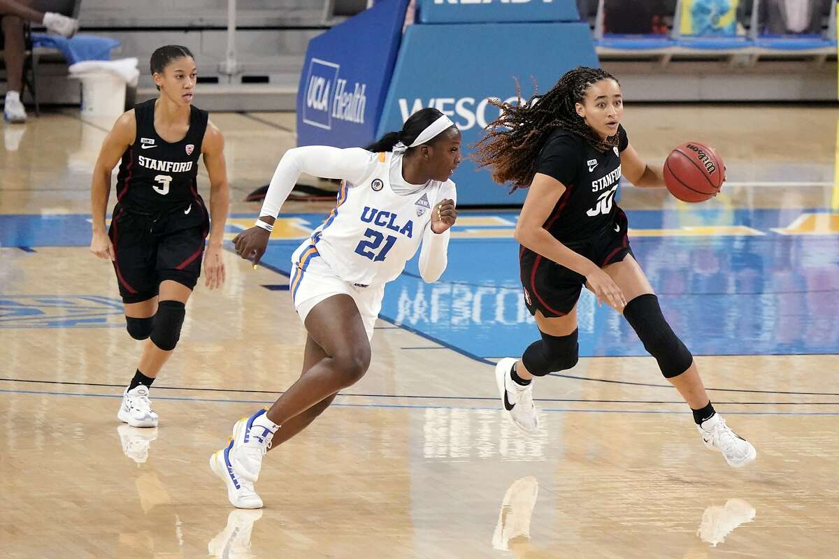 Stanford guard Haley Jones, right, dribbles next to UCLA forward Michaela Onyenwere during the first half of an NCAA college basketball game Monday, Dec. 21, 2020, in Los Angeles. (AP Photo/Marcio Jose Sanchez)