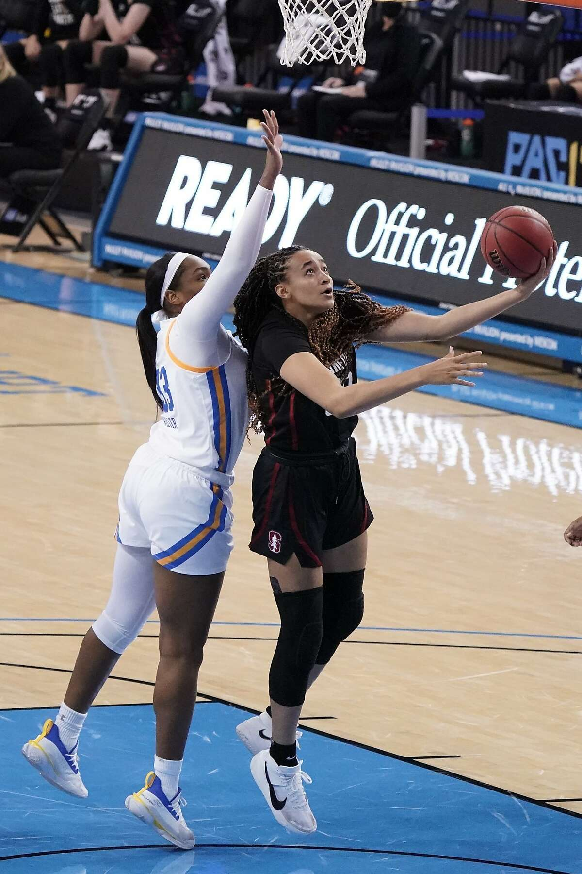 Stanford guard Haley Jones, right, shoots past UCLA forward Lauryn Miller during the first half of an NCAA college basketball game Monday, Dec. 21, 2020, in Los Angeles. (AP Photo/Marcio Jose Sanchez)