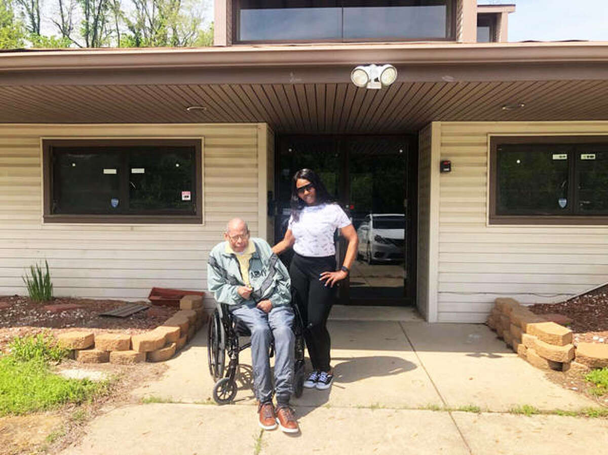 Norval Cox, former owner of the Godfrey Human Development Resource Center, is shown with new co-owner Diaunca Atkins, of Godfrey. Atkins, her son Jordan Atkins, and her mother Jeannie Atkins, purchased the building earlier this year with plans to provide an adult day care center and host various events.