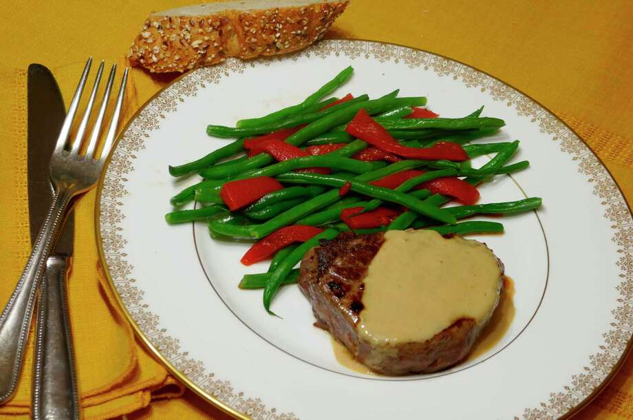 Beef tenderloin in cognac sauce with French green beans. (Linda Gassenheimer/TNS)