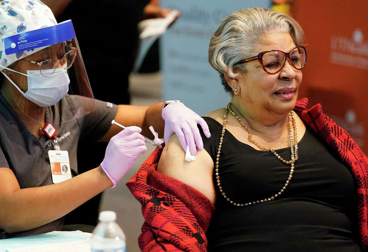 State Rep. Senfronia Thompson, D-Houston, gets a dose of the COVID-19 vaccine last Wednesday.