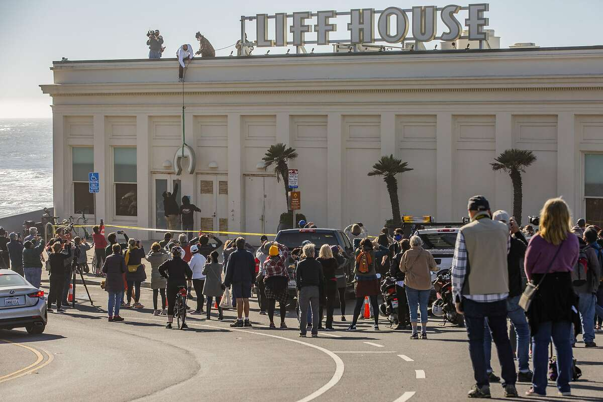 The Cliff House sign is taken down, Thursday, Dec. 31, 2020, in San Francisco, Calif. The 157-year-old Cliff House closed permanently.
