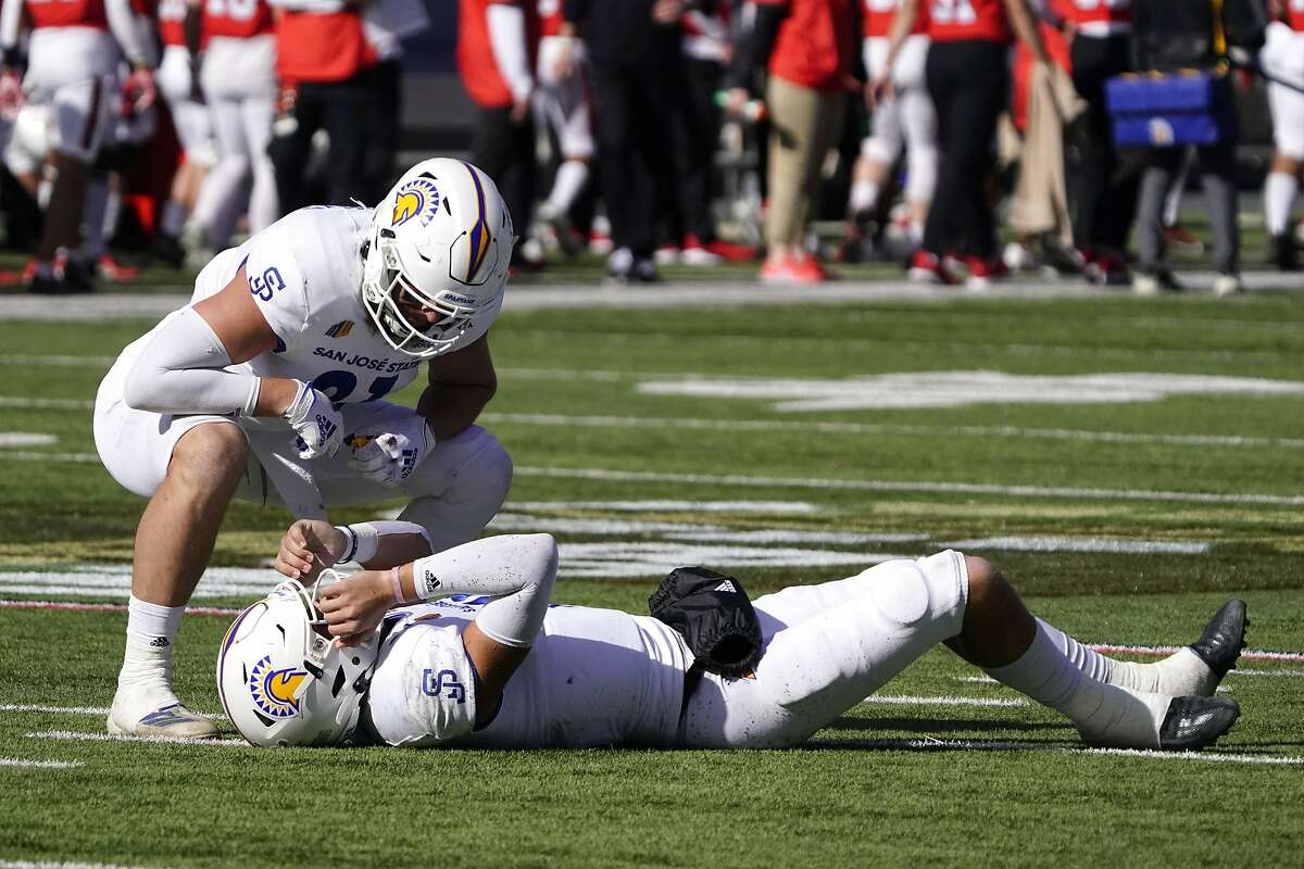 Spartans quarterback Nick Starkel was hurt in the first half, but would return.
