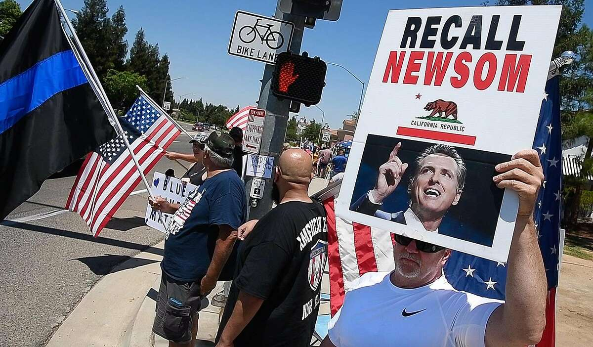About 75 protesters gathered at Shepherd and Cedar avenues in Fresno in an effort to gather signatures to recall California Gov. Gavin Newsom, and in support of President Donald Trump, on Saturday, July 18, 2020.