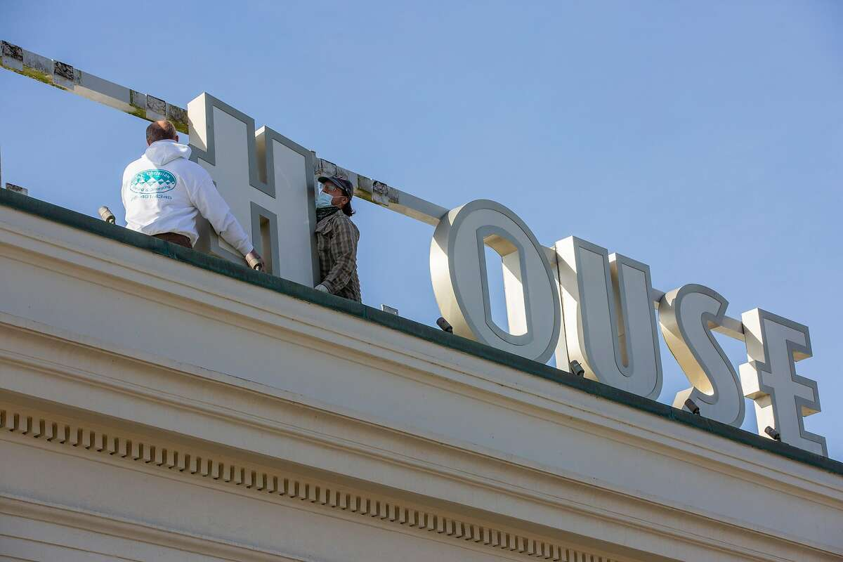 The Cliff House sign is taken down on the last day of 2020.