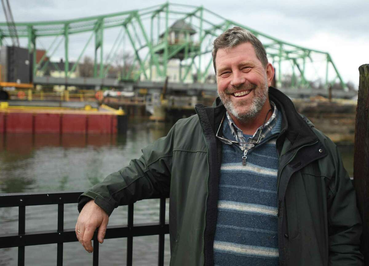 Long time environmental advocate Chris Ozyck stands by the ongoing restoration of the Grand Avenue bridge on the Quinnipiac River in New Haven, Conn. on Dec. 31, 2020. Ozyck has been named the Register's 2020 Person of the Year.