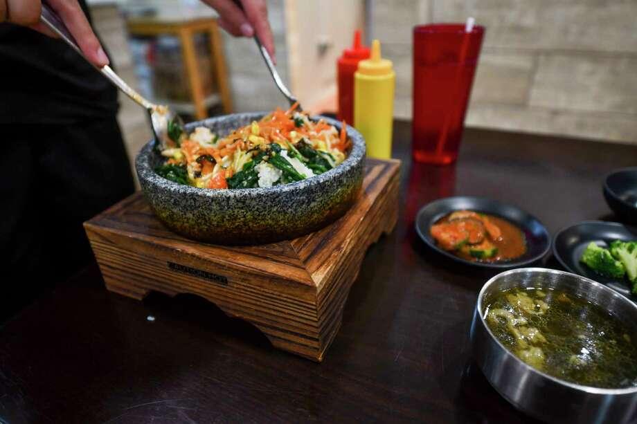 Bibimbap served on a hot stone dish at Oppa Korean Restaurant on Thursday, Dec. 31, 2020 at 3303 N. Midkiff Rd. Suite 129.   Jacy Lewis/Reporter-Telegram Photo: Jacy Lewis/Reporter-Telegram