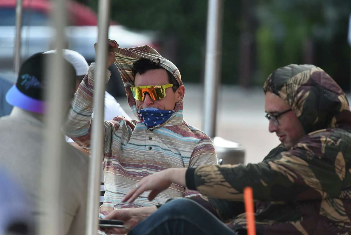 Steve Martin (center) hangs out with friends at the Pearl after discussing coronavirus protocols Tuesday afternoon.