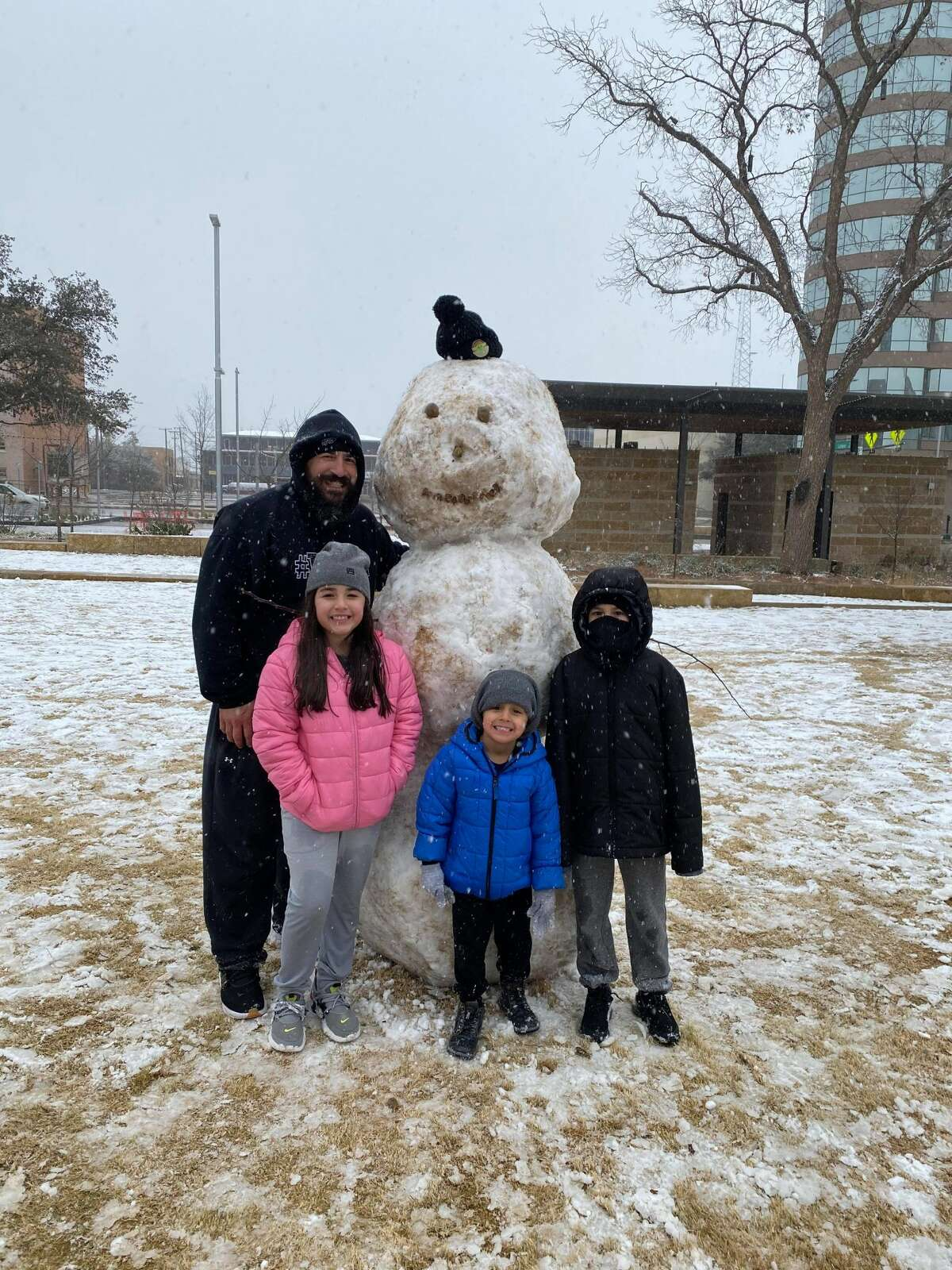 The Carrasco family enjoyed the snow that fell Wednesday, December 31, 2020, at Centennial Park in downtown Midland.