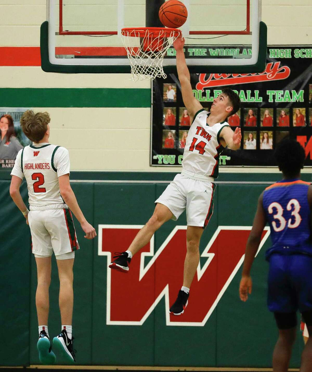 The Woodlands guard Isaiah Brown (14) makes a basket during the first quarter of a District 13-6A high school basketball game at The Woodlands High School, Thursday, Dec. 31, 2020, in The Woodlands.