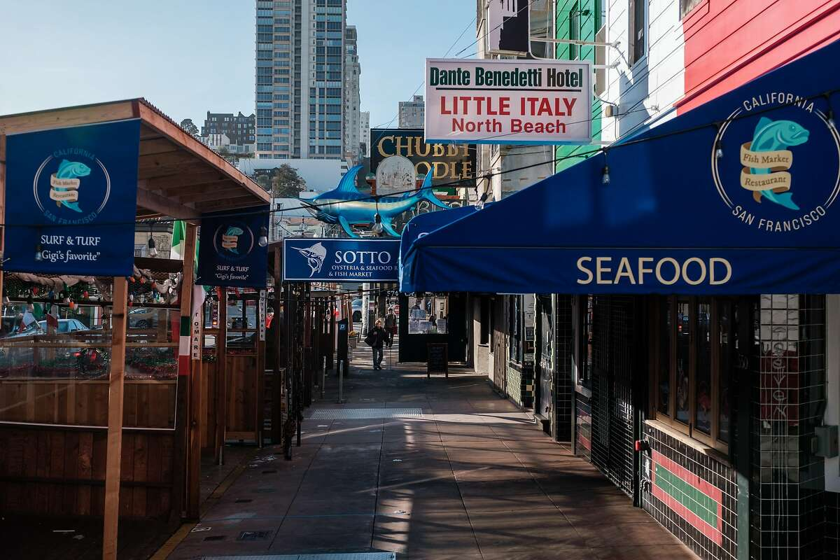 Few people are seen in a normally busy part of North Beach in San Francisco on Thursday, December 31, 2020. San Francisco is extending its shelter in place order indefinitely, impacting business throughout the city.