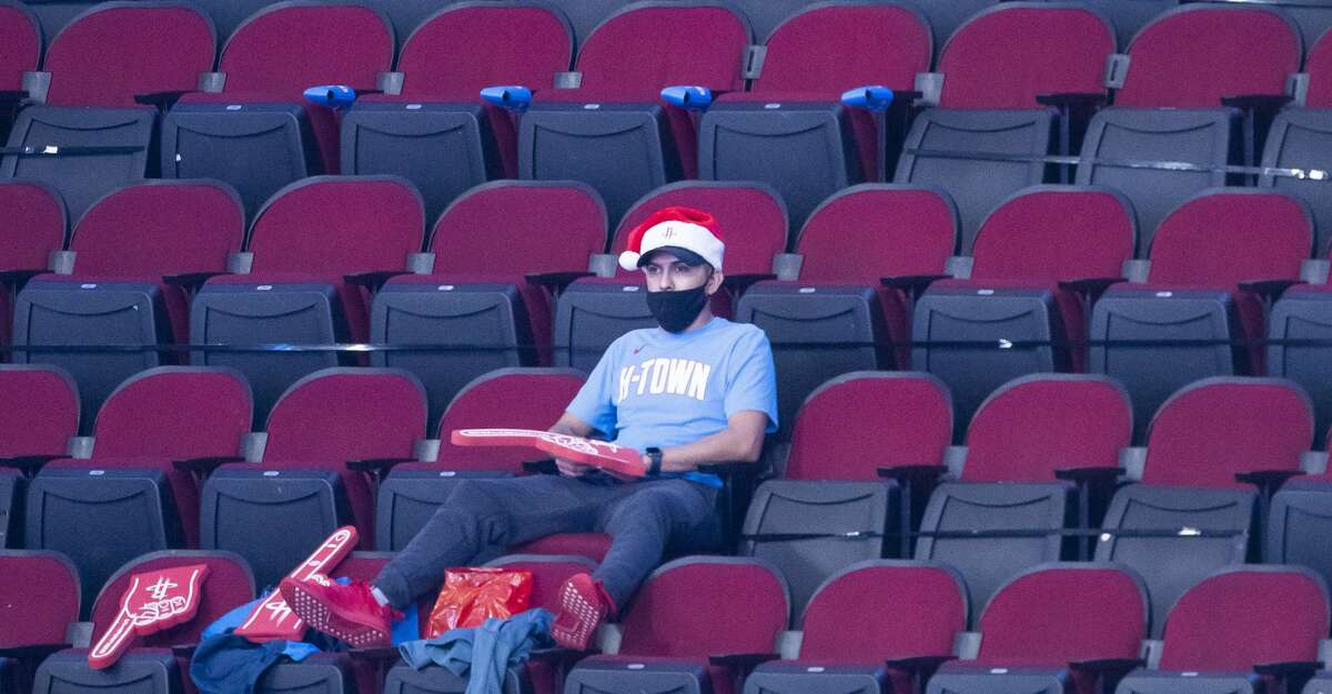 A fan watches as the Rockets warm up in their powder blue Oilers-inspired jerseys before an NBA game between the Houston Rockets and Sacramento Kings on Thursday, Dec. 31, 2020, at Toyota Center in Houston.