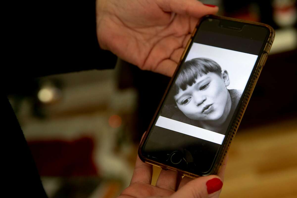 Stanphill displays a photo of her son when he was a child.