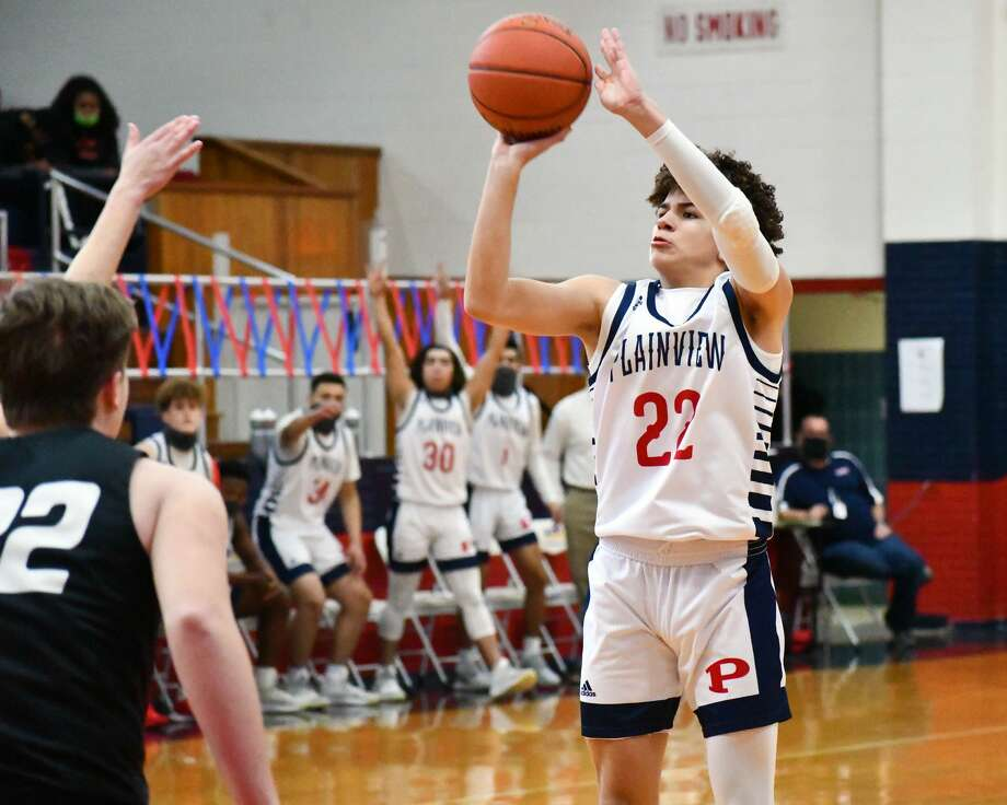 Plainview's Adolfo Martinez drills a 3-pointer in the Bulldogs' 62-50 win over Bushland on Thursday in the Dog House. Photo: Nathan Giese/Planview Herald