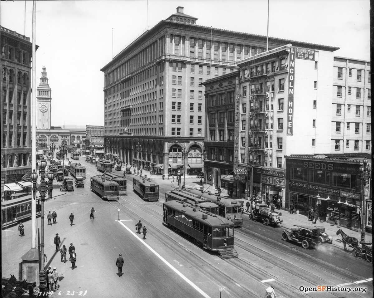 Though the city was modernizing, it was still geographically isolated, with no way to travel across the bay beyond a ferry ride. But within a decade plans would be afoot to build not one but two iconic bridges straddling the bay and the Golden Gate.  Here, streetcars, pedestrians, horses and cars all coexist on lower Market Street.