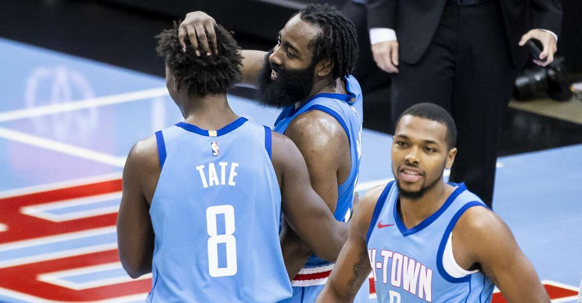 Houston Rockets guard James Harden (13) congratulates forward Jae'Sean Tate (8) at the end of the fourth quarter of the Houston Rockets 122-119 win over the Sacramento Kings on Thursday, Dec. 31, 2020, at Toyota Center in Houston.