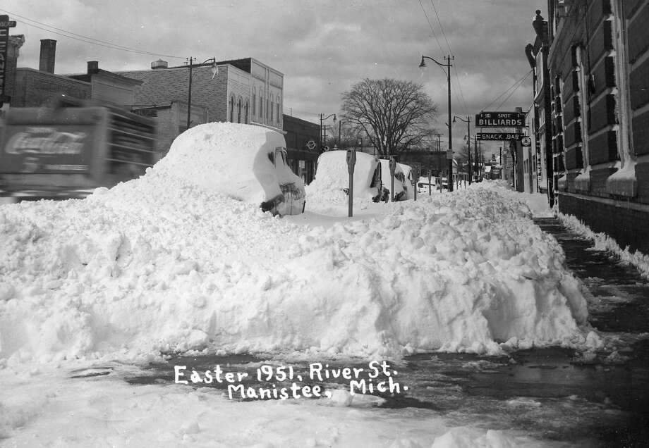 This photo shows a view looking west down River Street near Oak Street in the aftermath of the Easter snow storm of 1951. (Manistee County Historical Museum photo)