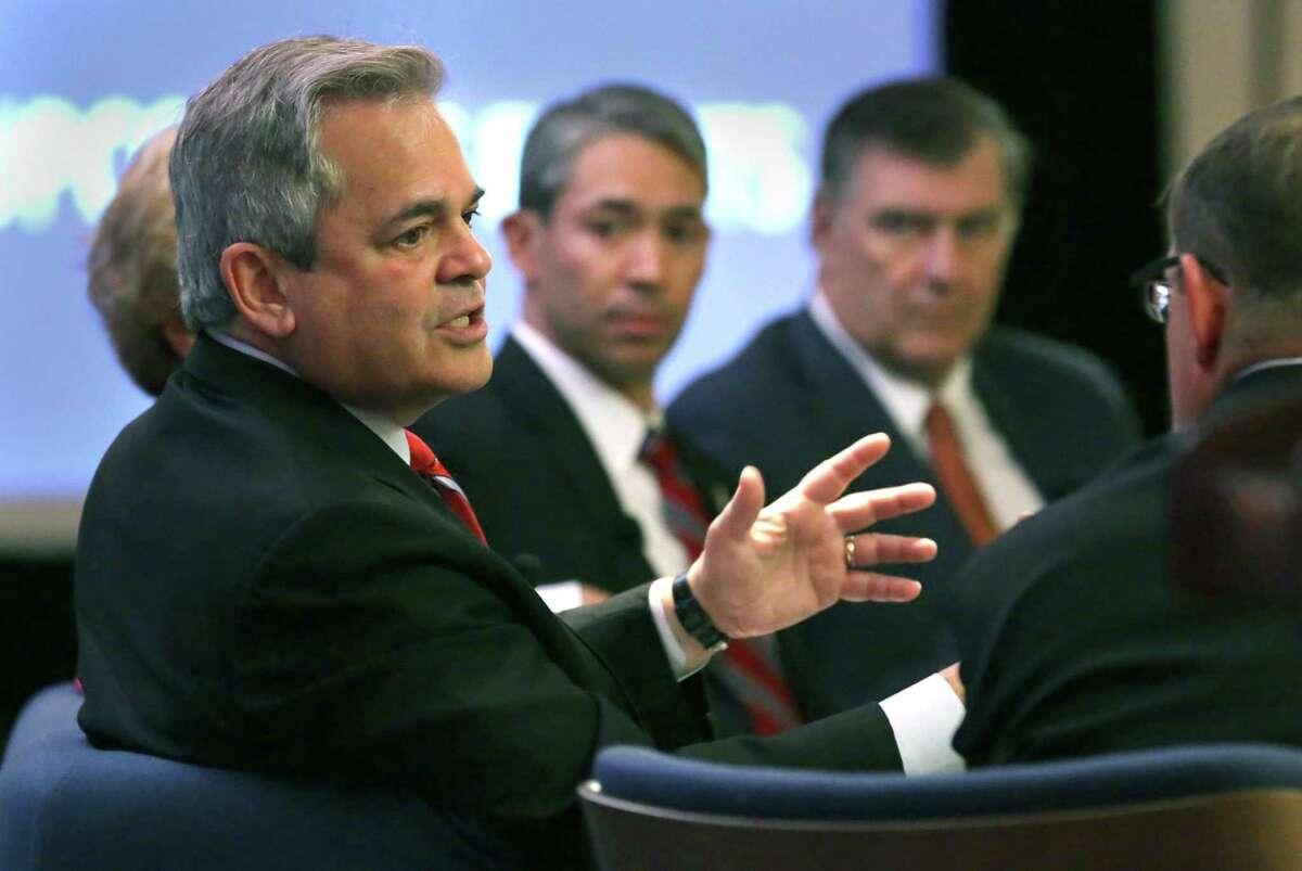 Mayor Steve Adler of Austin, left, speaks on a panel in 2018.