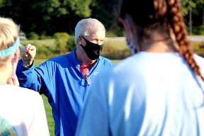 Lewis and Clark Community College women's soccer coach Tim Rooney, wearing a protective face mask, speaks with his players during an fall practice at LCCC. It was his team's first off-season practice of the year, since the NJCAA moved the season from fall to spring because of the COVID-19 pandemic. The pandemic affected nearly every sports story of 2020 in some way from March on.