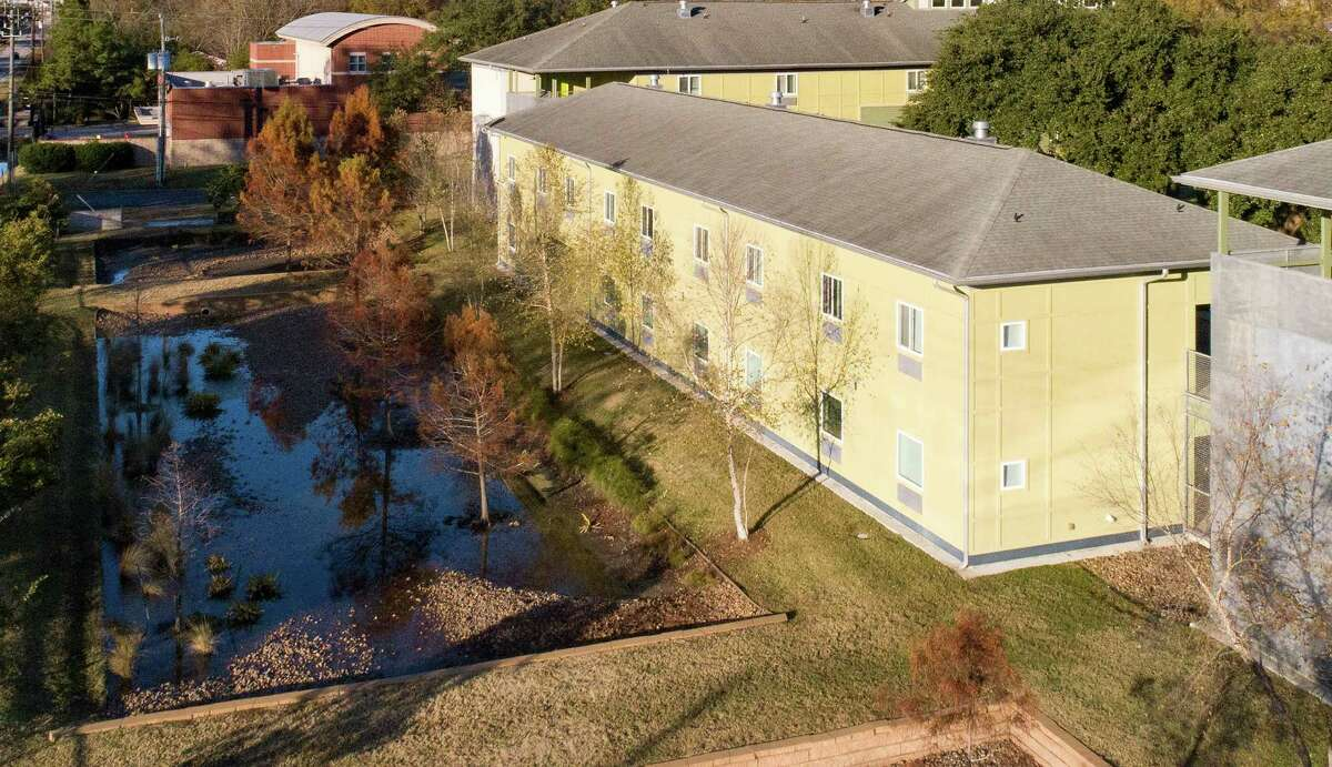 New Hope Housing's Rittenhouse development in Houston features an integrated area for stormwater. The city is hoping to spur similarly eco-minded developments with a new tax abatement program.