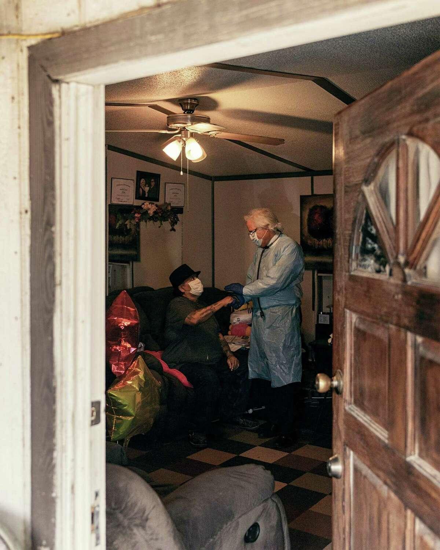 Dr. Ricardo Cigarroa visits Natividad Santana's home in the Cuatro Vientos neighborhood in April.