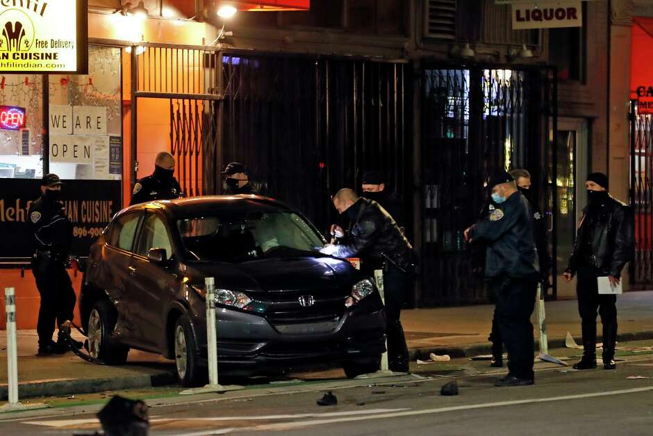 San Francisco police investigate the scene of a fatal hit-and-run on Second Street just north of Mission Street on Thursday. Parolee Troy Ramon McAlister, 45, has been accused of killing two pedestrians.