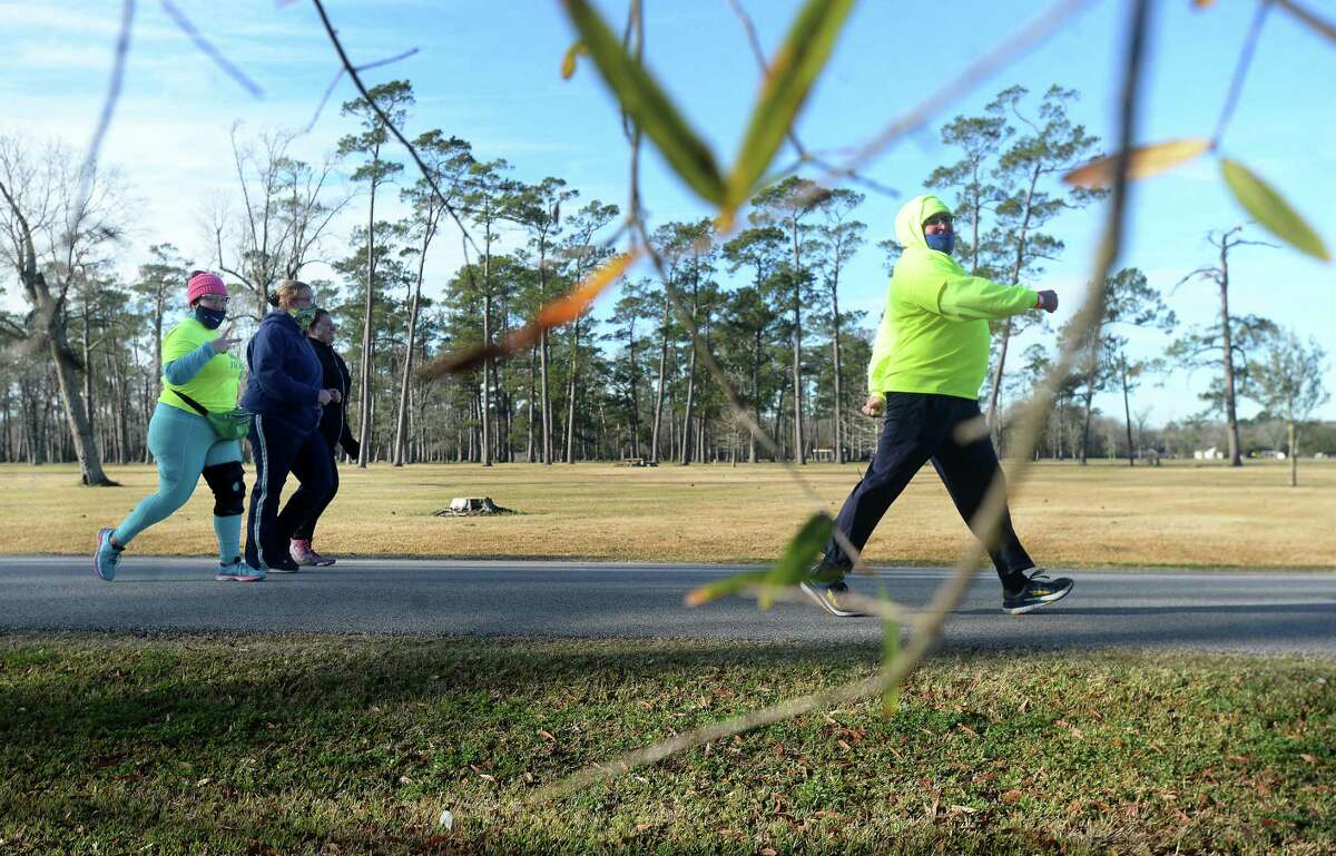 Runners and walkers make loops through Tyrrell Park as they join in Sea Rim Striders' annual Resolution Run 5K New Year's Day. Photo taken Friday, January 1, 2021 Kim Brent/The Enterprise