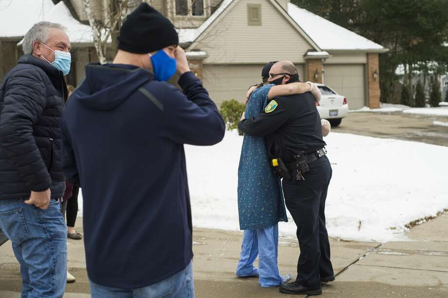 Midland Police Officer Tyler Hollingsworth greets his fellow officers after they escorted him back home Friday, Jan. 1, 2021 from his stay at Hurley Medical Center in Flint after he sustained injuries in the line of duty on Christmas Eve. (Katy Kildee/kkildee@mdn.net) Photo: (Katy Kildee/kkildee@mdn.net)