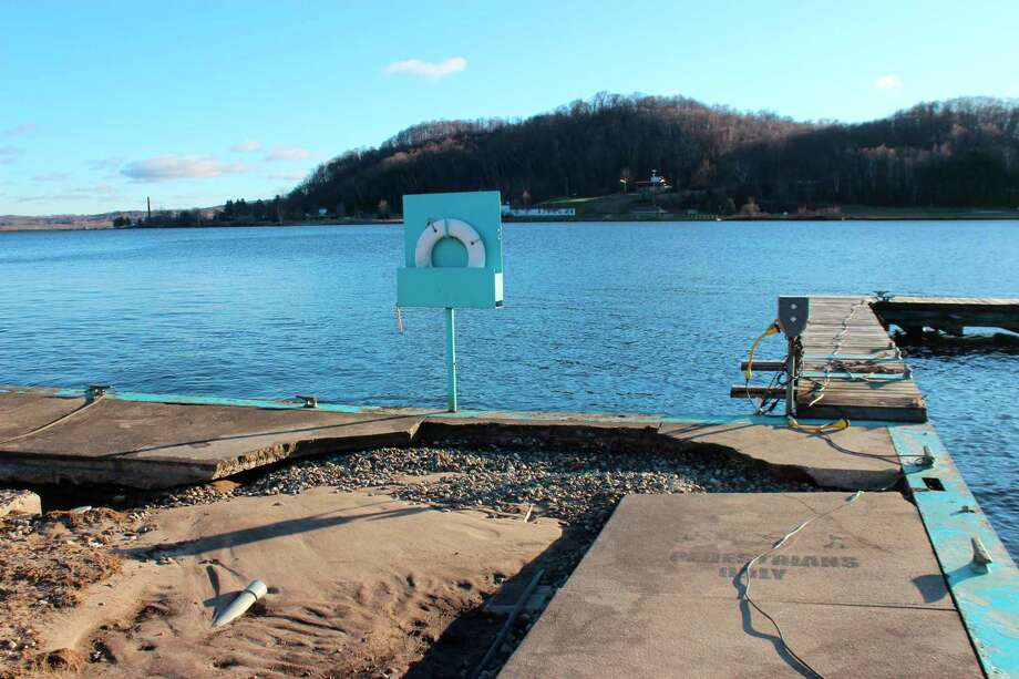 A section of concrete walkway damaged by waves and high water at Frankfort's marina. (File Photo)