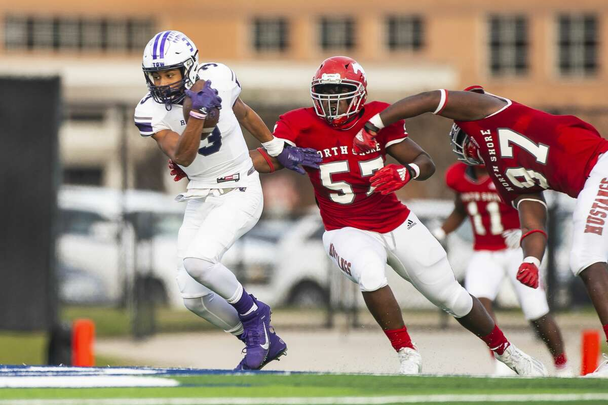 Ridge Point quarterback Bert Emanuel, Jr tries to evade the North Shore defense during a game between North Shore High School and Ridge Point High School on Friday, Jan. 1, 2021, at the Galena Park ISD Stadium in Galena Park, TX.