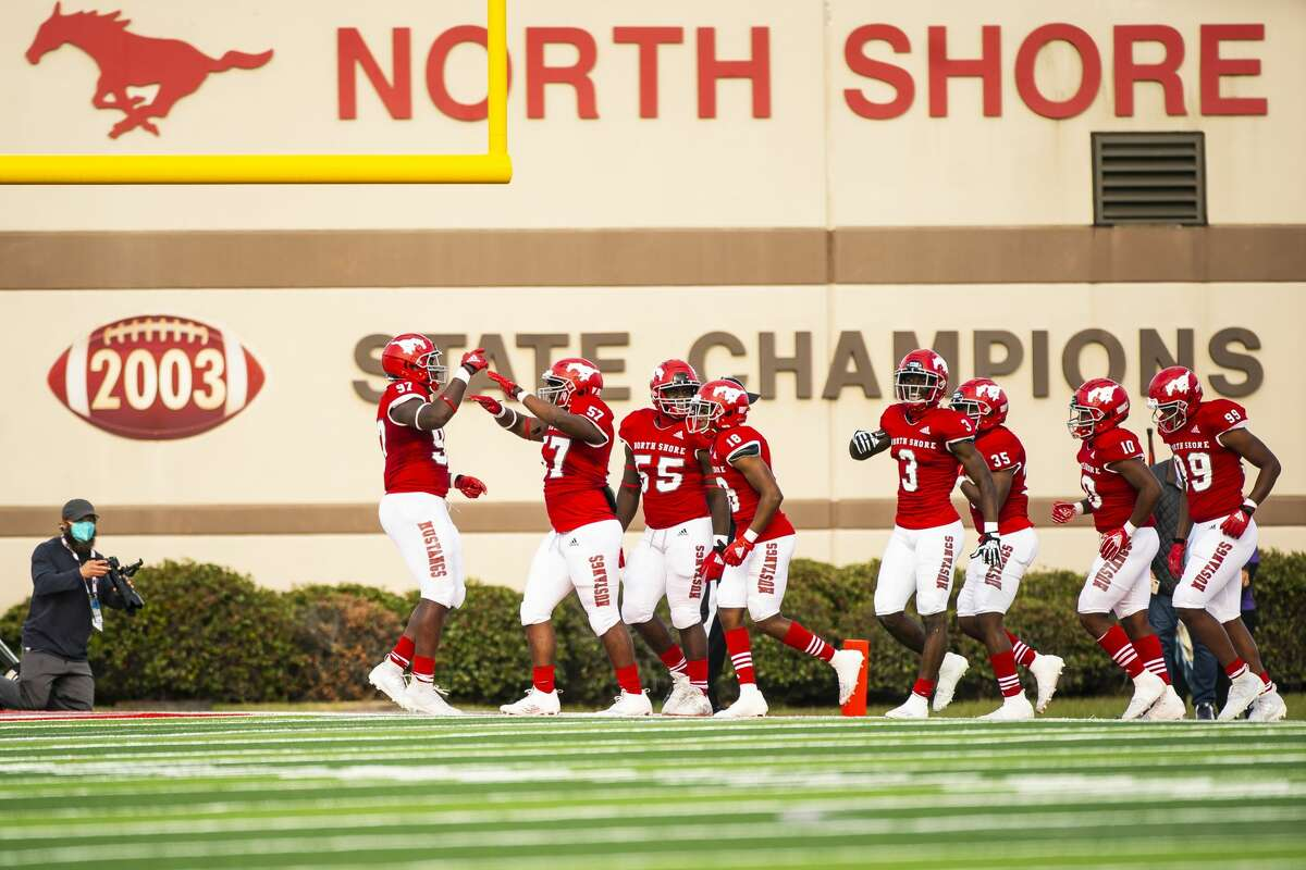 The North Shore defense celebrates a stop during a game between North Shore High School and Ridge Point High School on Friday, Jan. 1, 2021, at the Galena Park ISD Stadium in Galena Park, TX.
