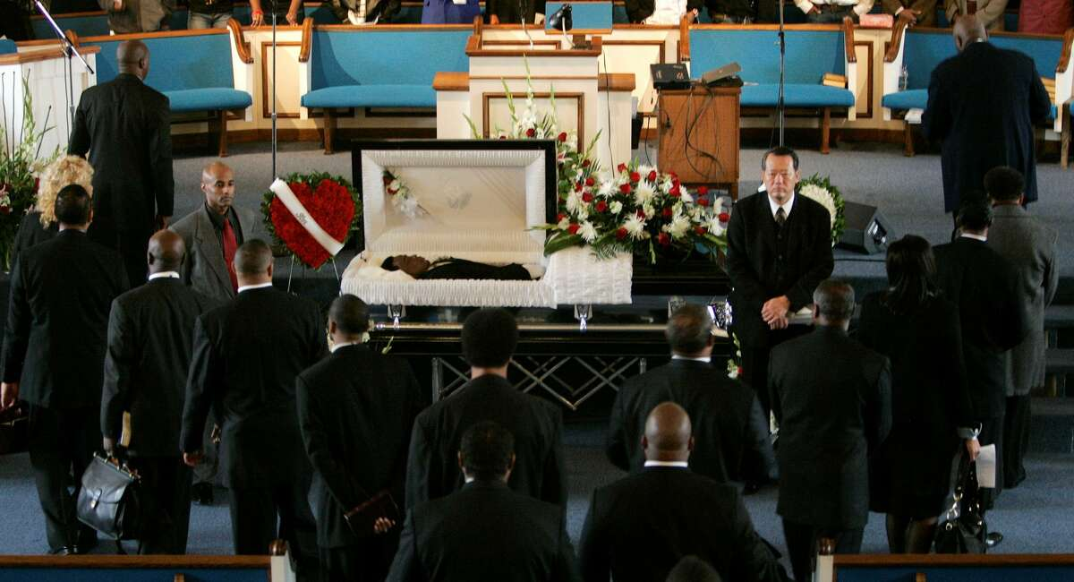 Clergy members surround the body of Oscar Grant during his funeral at the Palma Ceia Baptist Church in Hayward, Calif., Wednesday, Jan. 7, 2009. Grant was shot and killed by a police officer after an altercation on a BART train station platform in Oakland, Calif. on New Year's Day.
