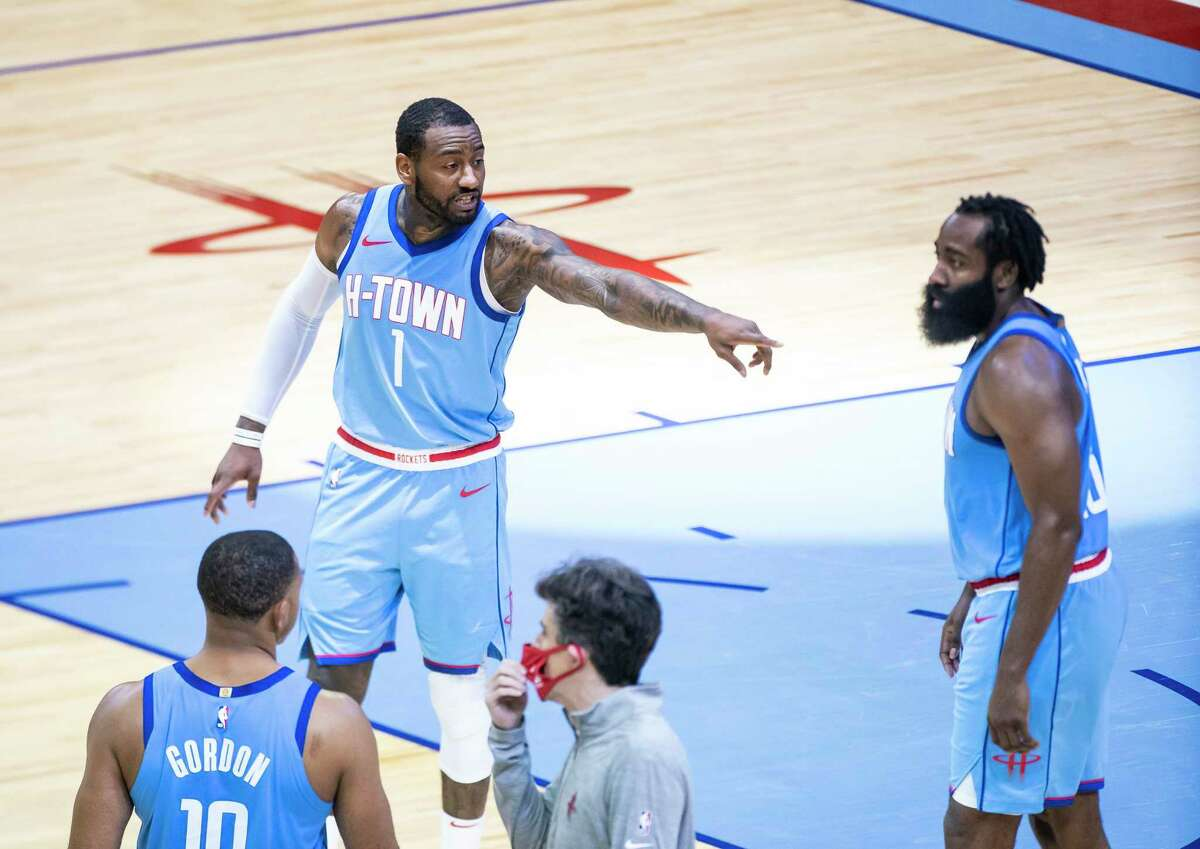 John Wall, talking with James Harden in the fourth qaurter against Sacramento, is quickly finding ways to work together.