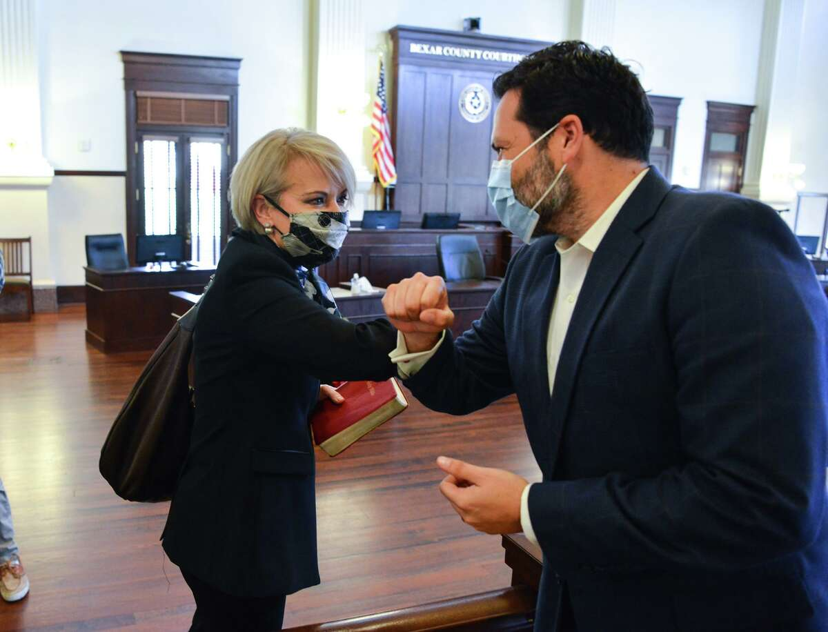 Commissioner Justin Rodriguez greets new Commissioner Trish DeBerry prior to swearing-in ceremonies shortly New Year's Day in the Bexar County Courthouse.