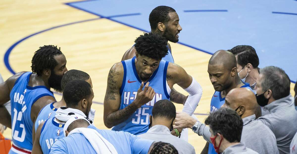 Houston Rockets forward Christian Wood (35) listen in the huddle during a time out during the fourth quarter of the Houston Rockets 122-119 win over the Sacramento Kings on Thursday, Dec. 31, 2020, at Toyota Center in Houston.