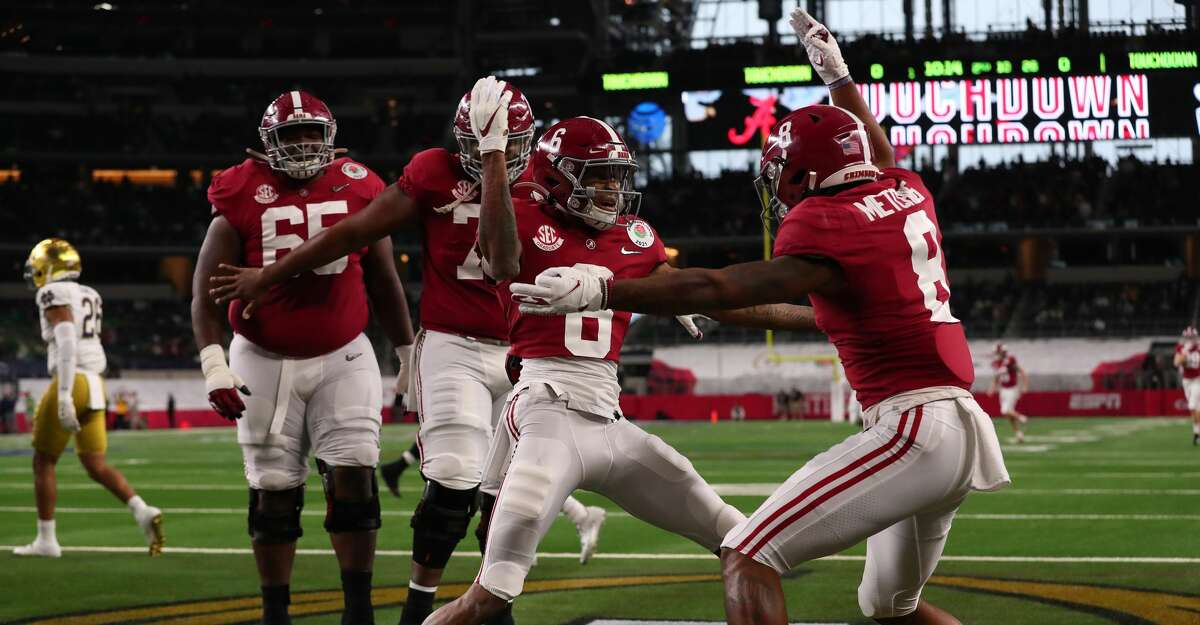 Wide receiver DeVonta Smith #6 of the Alabama Crimson Tide celebrates his touchdown with teammate wide receiver John Metchie III #8 interceptionhe first quarter of the 2021 College Football Playoff Semifinal Game at the Rose Bowl Game presented by Capital One against Notre Dame Fighting Irish at AT&T Stadium on January 01, 2021 in Arlington, Texas. (Photo by Tom Pennington/Getty Images)