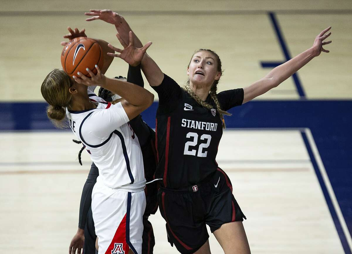 Cameron Brink reaches to block a shot by Arizona's Lauren Ware on Friday in Tucson, where Stanford lost last year.