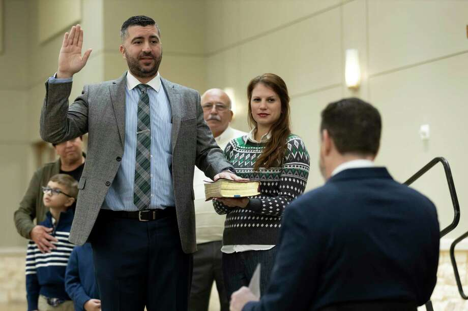 Vince Santini, 457th state District Court judge, raises his right hand while placing his left on a bible along side his wife Mary, as he's sworn in by 9th state District Court judge Phil Grant during a ceremony at the Lone Star Convention & Expo Center, Friday, Jan. 1, 2021, in Conroe. Photo: Gustavo Huerta, Houston Chronicle / Staff Photographer / 2020 © Houston Chronicle