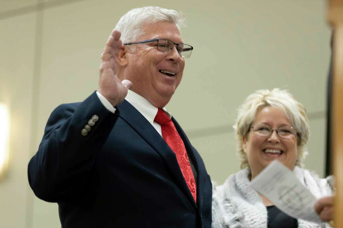 Commissioner Robert Walker and his wife Janet stand beside one another as Walker is sworn in during a ceremony at the Lone Star Convention & Expo Center, Friday, Jan. 1, 2021, in Conroe.