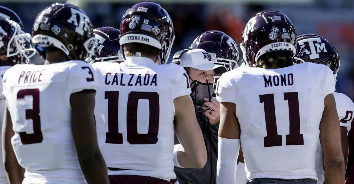Texas A&M head coach Jimbo Fisher talks with players in a timeout during the first half of an NCAA college football game against Auburn on Saturday, Dec. 5, 2020, in Auburn, Ala. (AP Photo/Butch Dill)