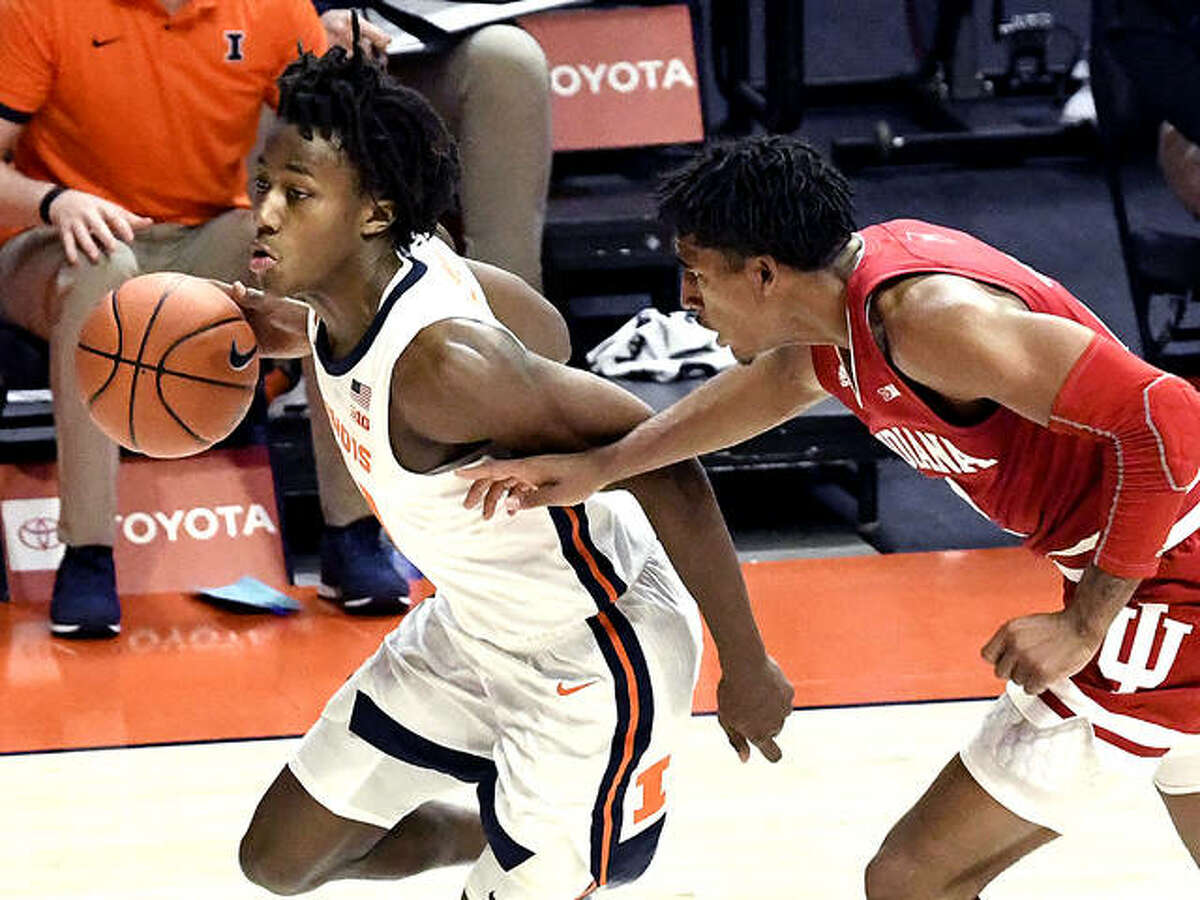 Illinois guard Ayo Dosunmu (11) powers past Indiana's guard Armaan Franklin (2) Saturday at State Farm Center in Champaign.