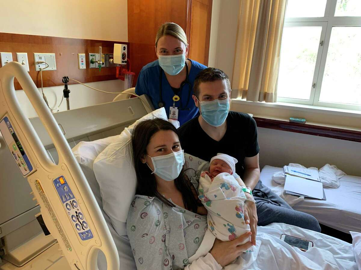 Dana and Matthew Wrigley of Stamford with baby Lilah and Niki Foley, RN