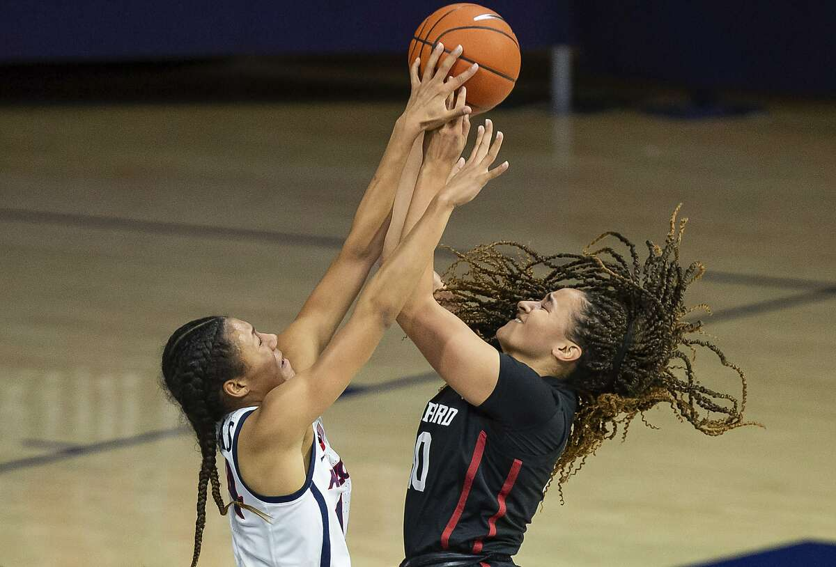 Arizona forward Sam Thomas (left) tries to block Stanford guard Haley Jones during an NCAA game in January in Tucson, Ariz. The Supreme Court has ruled that the NCAA can no longer put limits on education-related incentives that colleges offer to student athletes.